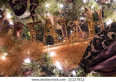 Christmas tree and decorations with the word FAITH - stock photo