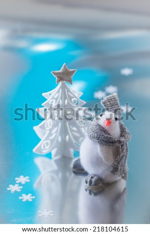 Christmas tree and  funny penguin