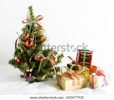Christmas tree and gifts on white background - stock photo