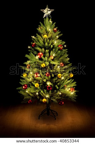 Christmas Tree and Gifts. Over black background - stock photo