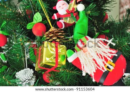 Christmas tree and santa claus - stock photo