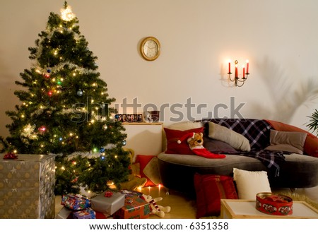 christmas tree at night time with candles and light setup - stock photo