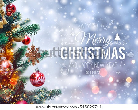 Christmas tree background and Christmas decorations with blurred, sparking, glowing and text Merry Christmas and Happy New Year. Xmas theme