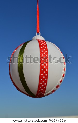 Christmas tree ball in the sky - stock photo