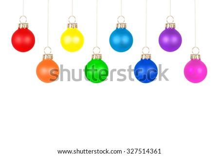 Christmas tree balls in eight different colors, isolated in front of white background - stock photo