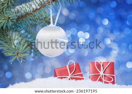 Christmas tree branch and decoration on abstract background - stock photo