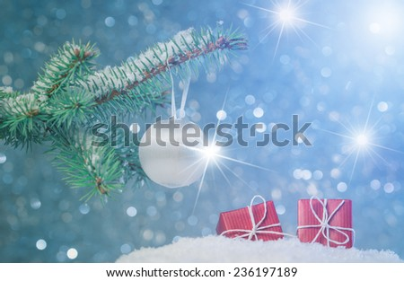 Christmas tree branch and decoration on abstract background with star luminous effect - stock photo