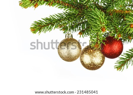 Christmas tree branch with decoration ball isolated on white - stock photo