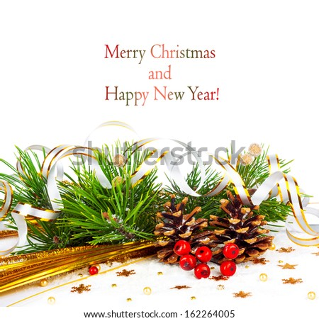 Christmas tree branch with gold serpentine and cones on white background isolated - stock photo