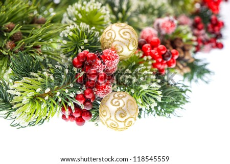 christmas tree branch with red berries and golden balls isolated on white background. festive decoration. selective focus - stock photo