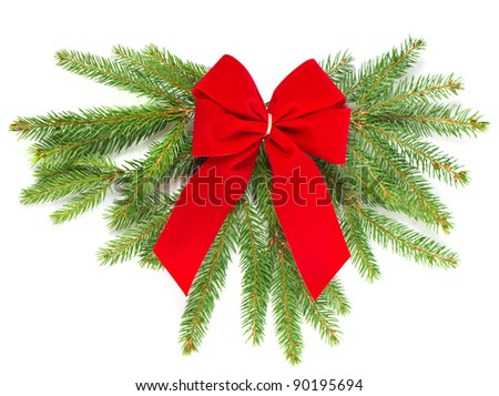 christmas tree branch with red ribbon. christmas decoration - stock photo