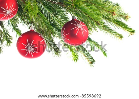 christmas tree; branches of fir with red christmas bauble - stock photo