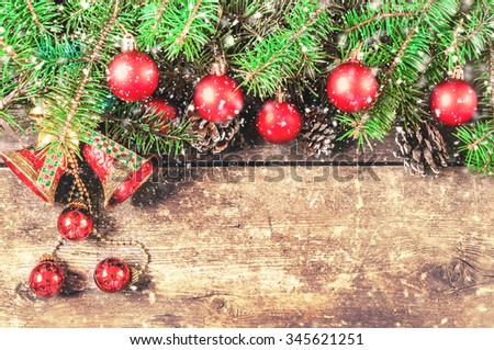 Christmas tree branches on old boards. Christmas background. Christmas decorations. New Year background. Xmax background. Toned image. Falling Snow. - stock photo