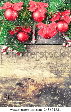 Christmas tree branches on old boards. Christmas background. Christmas decorations. New Year background. Xmax background. Toned image. Falling Snow . - stock photo