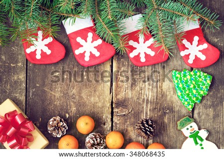 Christmas tree branches on old boards. Christmas background. Christmas Socks. Christmas decorations. New Year background. Xmax background. Toned image. - stock photo