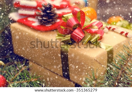 Christmas tree branches on old boards. Christmas background. Christmas Socks. Christmas decorations. New Year background. Xmax background. Valentine Day. Toned image. Falling Snow. - stock photo