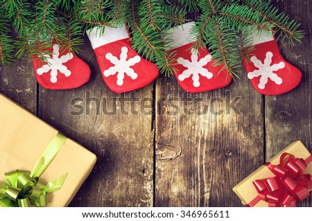 Christmas tree branches on old boards. Christmas Socks. Christmas decorations. New Year background. Xmax background. Toned image. - stock photo
