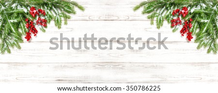 Christmas tree branches on wooden background. Festive decoration. Winter holidays banner - stock photo