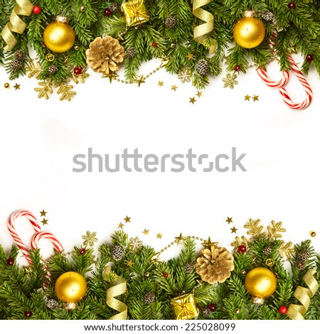 Christmas tree branches with golden baubles, stars, snowflakes -  border isolated on white - horizontal - stock photo