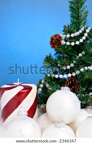 Christmas tree, candle and white ornaments
