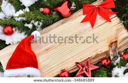 Christmas tree closeup angel red balls snow decoration  wooden texture - stock photo