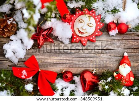 Christmas tree closeup red balls snow decoration stars wooden texture - stock photo