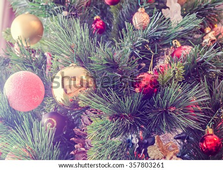 Christmas tree colored ornaments, globes hanging, snow flakes, green tree, firs, close up. - stock photo