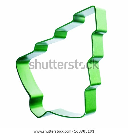 Christmas Tree cookie cutter isolated on white background. Green Cookie form.