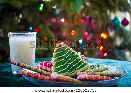 Christmas Tree Cookies and a glass of Milk for Santa - stock photo