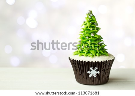 Christmas tree cupcake - stock photo
