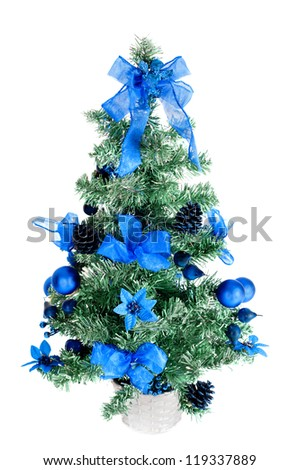 christmas tree decorated with an angel on top - stock photo
