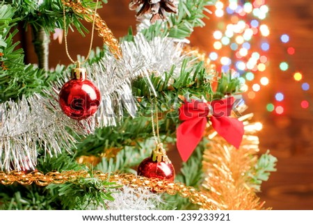 Christmas tree decorated with Christmas decorations on a background of lights garland - stock photo