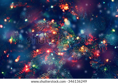 Christmas tree decorated with garlands, close-up - stock photo