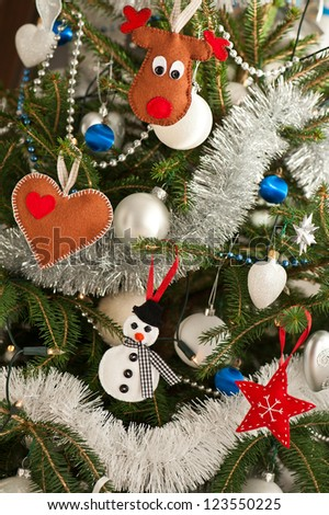 Christmas tree decorated with handmade felt toys - stock photo