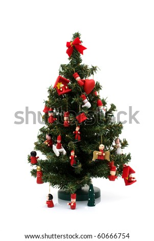 Christmas tree decorated with old fashion wooden ornaments isolated on white