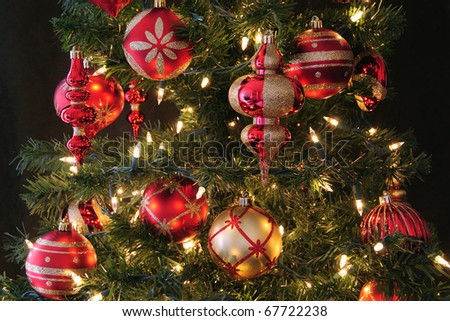 Christmas tree decorated with ornaments and lights - stock photo