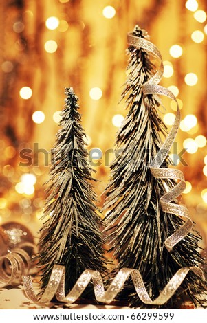 Christmas tree decoration as holiday background with winter ornament & abstract gold defocus lights - stock photo