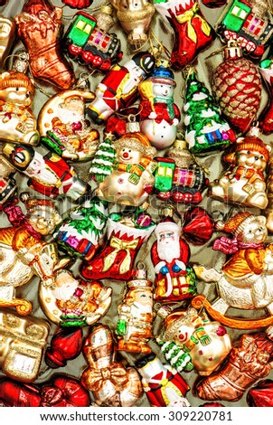 Christmas tree decoration baubles, toys and colorful ornaments. Vibrant colors. Vintage style toned picture - stock photo