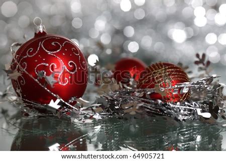 Christmas tree decoration on silver blurred background - stock photo