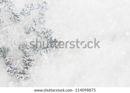 Christmas tree decoration on snow. Abstract background