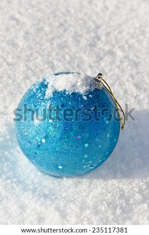 Christmas-tree decoration on snow and glitters in the sunlight, soft focus - stock photo