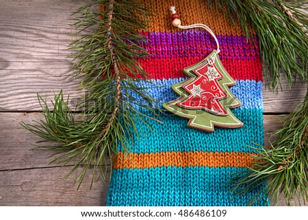 Christmas tree decoration on wooden texture background woolen warm wear texture new year