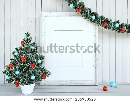 Christmas Tree Decoration with empty frame on white wood background - stock photo