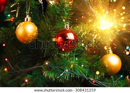 Christmas tree decoration with shiny sparkler - stock photo