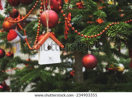 Christmas tree decoration wooden house ornament close up - stock photo