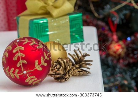 Christmas tree decorations and gifts in a festive interior - stock photo