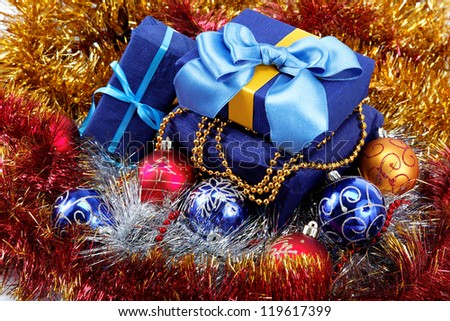 Christmas-tree decorations and gifts on a white background