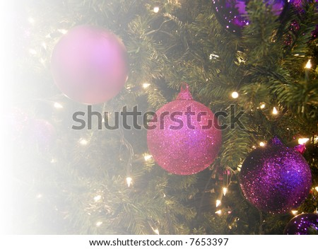 Christmas tree decorations fading to white on left
