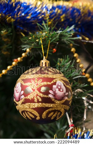 Christmas tree decorations hang on fir-tree branches waiting for Christmas approach