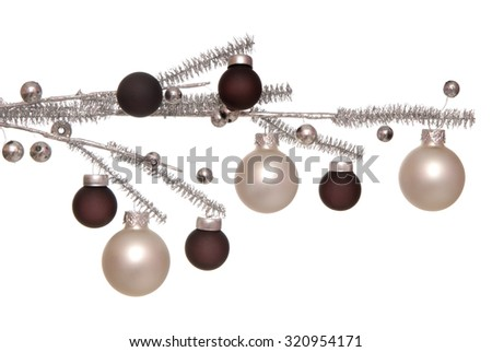 Christmas-tree decorations is on silvery branch.
